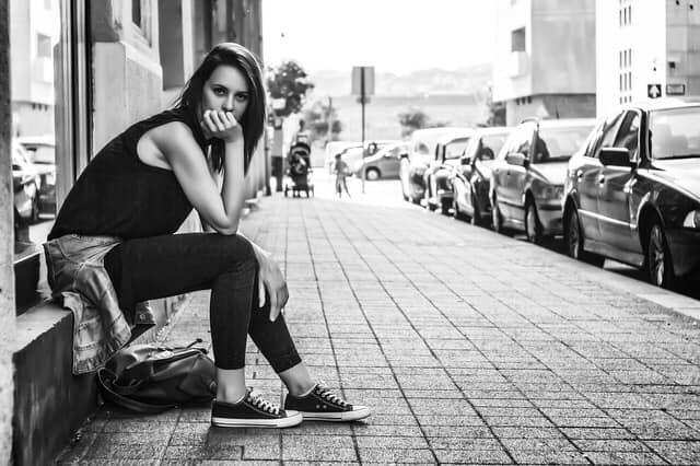 Girl sitting alone